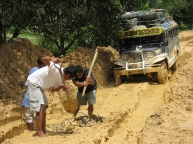 digging the jeepney out of the mud